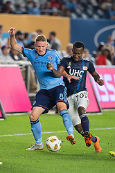 September 5, 2018 - Bronx, New York, United States - New York City midfielder ALEXANDER RING #8 fights for the ball against New England Revolution forward CRISTIAN PENILLA #70 during a regular season match at Yankee Stadium in Bronx, NY.  New England Revolution defeats New York City FC 1 to 0 (Credit Image: © Mark Smith/ZUMA Wire)