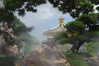Humidifiers (misters) in a rock garden with golden pagoda, The Pavilion of Absolute Perfection, Nan Lian Garden, Kowloon (Diamond Hill), Hong Kong, August 2008. The Nan Lian garden is built on a classical design of the Tang Dynasty, with rocks, ponds, and plantings.   Photo: Peter Llewellyn