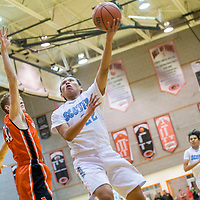 Window Rock Scout Burk Williams (22), center, releases left hook around an Artesia Bulldog during the Bengal Boys Basketball Invitational Tournament at Gallup High School Friday.