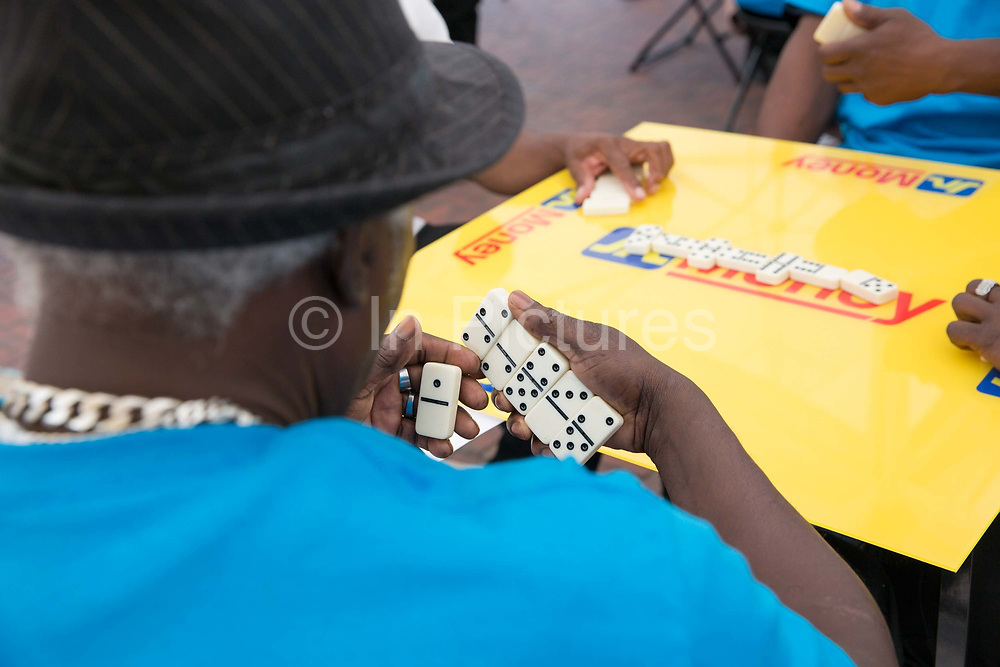 People play in a dominoes tournament at Windrush Square to celebrate the 70th anniversary of the arrival of the passenger liner, Empire Windrush, and the men and women who came to England from the Caribbean on the 23rd June 2018 in Brixton in the United Kingdom. The arrival of 492 passengers from the Caribbean on the 22 June 1948 marked a seminal moment in Britain's history. (photo by Sam Mellish / In Pictures via Getty Images)