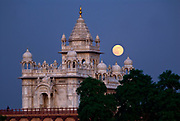 A full moon rises over the Jaswant Thada Cenotaph, a white marble memorial that sits just outside the Mehangarh Fort complex.