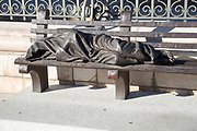Homeless Jesus sculpture by the cathedral, Madrid city centre, Spain