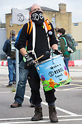 A samba drummer from Extinction Rebellion attends a protest against the expansion of Stansted Airport on 29 August 2020 in Bishops Stortford, United Kingdom. The activists are calling on Manchester Airports Group to withdraw their appeal, for which planning permission was previously refused by Uttlesford District Council, to be able to expand Stansted Airport from a maximum of 35 million to 43 million passengers a year, as well as calling on the Government to halt all airport expansion in order to maintain its commitments under the Paris Agreement.