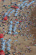 QINGDAO, CHINA - AUGUST 17: (CHINA OUT) <br /> <br /> Hugh Crowds Enjoy The Beach<br /> <br /> The image shows Crowds of people on the Zhanqiao beach on August 17, 2014 in Qingdao, Shandong Province of China. <br /> ©Exclusivepix
