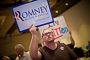 28 FEBRUARY 2012 - PHOENIX, AZ:    Mitt Romney supporter ADAM CLAUSING from El Mirage, AZ, cheers when early results showing Mitt Romney leading over Rick Santorum come in to a Phoenix, AZ, hotel ballroom. Several hundred Romney supporters crowded into a ballroom in a Phoenix hotel to watch primary results from Michigan and Arizona. Romney won the night, scoring a tight win in the Michigan Republican Presidential primary and a comfortable win in the Arizona Republican Presidential primary.     PHOTO BY JACK KURTZ
