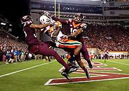 Oct 20, 2016; Blacksburg, VA, USA; Miami Hurricanes wide receiver Stacy Coley (3) catches a ball in the end zone but lands of bounds against Virginia Tech Hokies defensive back Chuck Clark (19) and cornerback Adonis Alexander (36) during the fourth quarter at Lane Stadium. Mandatory Credit: Peter Casey-USA TODAY Sports