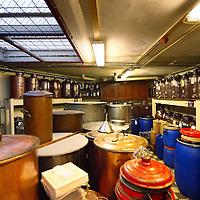 Nederland, Amsterdam , 28 oktober 2013.<br /> A.van Wees distilleerderij de Ooievaar is een distilleerderij ontstaan uit de Amsterdamse distilleerderij A.van Wees anno 1883 en de Haagse distilleerderij de Ooievaar anno 1782. Wij zijn nog steeds gevestigd in de Amsterdamse Driehoekstraat midden in de Jordaan.<br /> De distilleerderij is een familiebedrijf, waarbij inmiddels de 3e generatie van Wees aan het roer staat. Wij maken momenteel 17 soorten genevers en ongeveer 60 typisch Nederlandse likeuren, plus nog bijna alle dranken die u bijna nergens meer tegenkomt. Zoals Angostura, Maagbitter, Fladderack, Voorburgh, Crème de Menthe, Abricot Brandy en nog vele andere authentieke dranken.<br /> Alle producten worden gedistilleerd op basis van natuurlijk grondstoffen en originele receptuur. Wij gebruiken geen kunstmatige geur- of smaakstoffen. Dat is voor Nederlandse begrippen, maar ook buitenlandse een unieke werkwijze.<br /> Foto:Jean-Pierre Jans