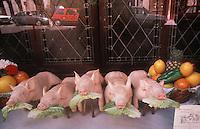 pigs figures outside a restaurant in Toledo,Spain - photograph by Owen Franken