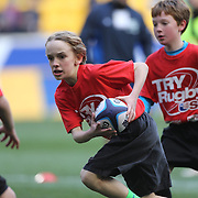 Youngsters playing touch rugby during the half time interval during the London Irish Vs Saracens Aviva Premiership Rugby match, the first Premiership game to be played overseas at Red Bull Arena, Harrison, New Jersey. USA. 12th March 2016. Photo Tim Clayton