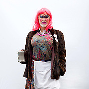 Portrait of a member of the Norwich Kitwitches at A Day of Dance, the largest annual gathering of Molly dancers in the UK in Ely on 27th January 2018. Molly dancing is a form of English Morris dance and is one of the traditional dances from the fens of East Anglia. It traditionally only appeared during the depths of winter as a means of earning some money when the land was frozen or waterlogged and could not be worked