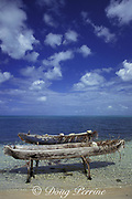 traditional dugout fishing canoes on Half Moon Caye, on the barrier reef of Lighthouse Reef Atoll, Belize, Central America ( Caribbean Sea )