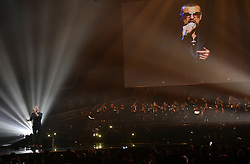 Coldplay's Chris Martin performs a tribute to George Michael on stage at the Brit Awards at the O2 Arena, London.