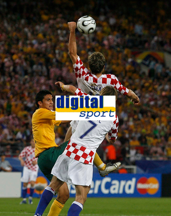 Photo: Glyn Thomas.<br /> Croatia v Australia. Group F, FIFA World Cup 2006. 22/06/2006.<br /> Croatia's Stiepan Tomas (top) handballs to award Australia a penalty.