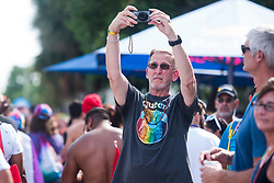 June 16, 2018 - Wilton Manors, Florida, U.S - Spectators watch the parade during the 19th annual Stonewall Pride Parade and Festival in Wilton Manors, FL. The parade commemorates the 1969 riots in New York City after a police raid at the Stonewell Inn night club. (Credit Image: © Orit Ben-Ezzer via ZUMA Wire)