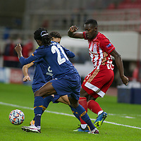 PIRAEUS, GREECE - DECEMBER 09: Mohamed Camara of Olympiacos FC and  Romário Baró of FC Porto during the UEFA Champions League Group C stage match between Olympiacos FC and FC Porto at Karaiskakis Stadium on December 9, 2020 in Piraeus, Greece.(Photo by MB Media)