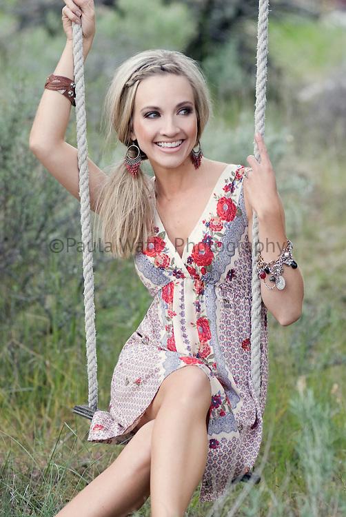 Shannon Bex of Danity Kane on swing in field