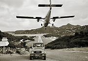 Sepia photo of airplane making a tricky landing in St. Barthelemy airport, FWI