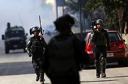 08.10.2015, Ramallah, PSE, Gewalt zwischen Palästinensern und Israelis, im Bild Zusammenstösse zwischen Palästinensischen Demonstranten und Israelischen Sicherheitskräfte // Israeli security forces take position during clashes with Palestinian protesters in Beit El, near the West Bank city of Ramallah. New violence rocked Israel and the Israeli occupied West Bank, including an incident in which men thought to be undercover Israeli police opened fire on Palestinian stone throwers they had infiltrated, wounding three of them, Palestine on 2015/10/08. EXPA Pictures © 2015, PhotoCredit: EXPA/ APAimages/ Shadi Hatem<br /> <br /> *****ATTENTION - for AUT, GER, SUI, ITA, POL, CRO, SRB only*****