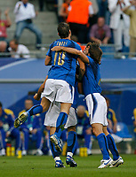 Photo: Glyn Thomas.<br />Italy v Ukraine. Quarter Finals, FIFA World Cup 2006. 30/06/2006.<br /> Italy's Gianluca Zambrotta is mobbed by teammates after scoring his side's early goal.