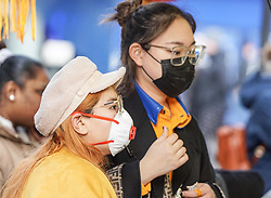 © Licensed to London News Pictures. 31/01/2020. Manchester , UK . Two women wear a protective mask as they stopped at a Chinese shop  in Central Manchester. Two people in the same family have been diagnosed with the Coronavirus in the UK, which has killed at least 213 people in China Photo credit: Ioannis Alexopoulos /  LNP