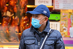 © Licensed to London News Pictures. 29/01/2020. London, UK. A man is seen in London's Chinatown wearing a face mask following the outbreak of Coronavirus in Coronavirus in Wuhan, China which has killed 132 people and infected more than 6,000. According to the Department of Heath, 97 people have been tested for Coronavirus in the UK and all have been confirmed negative. Photo credit: Dinendra Haria/LNP