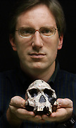 H&S10/21/03  Photo by Mara Lavitt--Michael Rogers<br /> ML0094F #7176<br /> SCSU anthropolgy assistant professor Michael Rogers with a cast of Homo habilis (the original skull resides at the National Museums of Kenya in Nairobi.  Rogers has found very early evidence of toolmaking in Ethiopia.