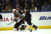 St. Louis Blues defenseman Roman Polak (46) pushes into Calgary Flames center Blair Jones (19) in the third period during a game between the Calgary Flames and the St. Louis Blues on Thursday April 25, 2013 at the Scottrade Center in downtown St. Louis.