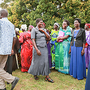 CAPTION: Part of the crowd of friends and family that came to witness the TLT graduation ceremony. LOCATION: Kaberamaido, Kaberamaido District, Uganda. INDIVIDUAL(S) PHOTOGRAPHED: Multiple people.