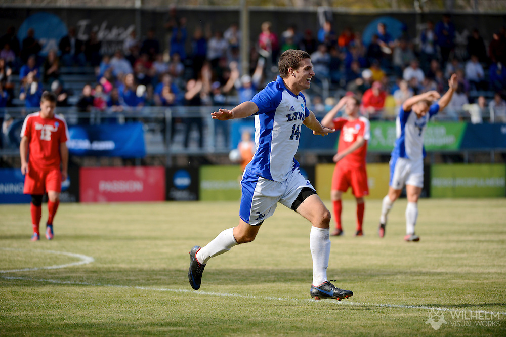 01 DEC 2012: Anthony Desperito (14) of Lynn University celebrates his goal against Saginaw Valley State University during the 2012 NCAA Men's Division II Soccer Championship held at Blanchard Woods Park hosted by the Peach Belt Conference in Evans, GA. Lynn defeated Saginaw Valley State 3-2 to win the national title. Brett Wilhelm/ NCAA Photos