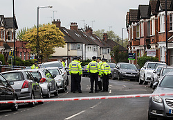 © Licensed to London News Pictures. 28/04/2017. London, UK. A police cordon around a property in Willesden, North London which was raided by anti-terror police in the early hours of this morning. A woman was shot and four people were arrested in the raid. Photo credit: Graham Eva/LNP