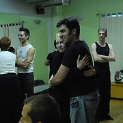 "Dancer and event producer Solomon Singer, center right, hugs his opposite sex country western dance partner Nell Mooney, center left, during a rehearsal for ""A Show Unlike Anything on Broadway!"" at Stepping Out Studios in Manhattan on May 2, 2007 in preparation for the 5 Boro Dance Challenge...The locally produced 5 Boro Dance Challenge, New York City's first same-sex dance competition, was held at the Park Central Hotel in Manhattan from May 4-6, 2007. ..The show was the entertainment presented in addition to the competition. ..Mooney volunteered as a participant in the show as a favor to her dance partner. .."