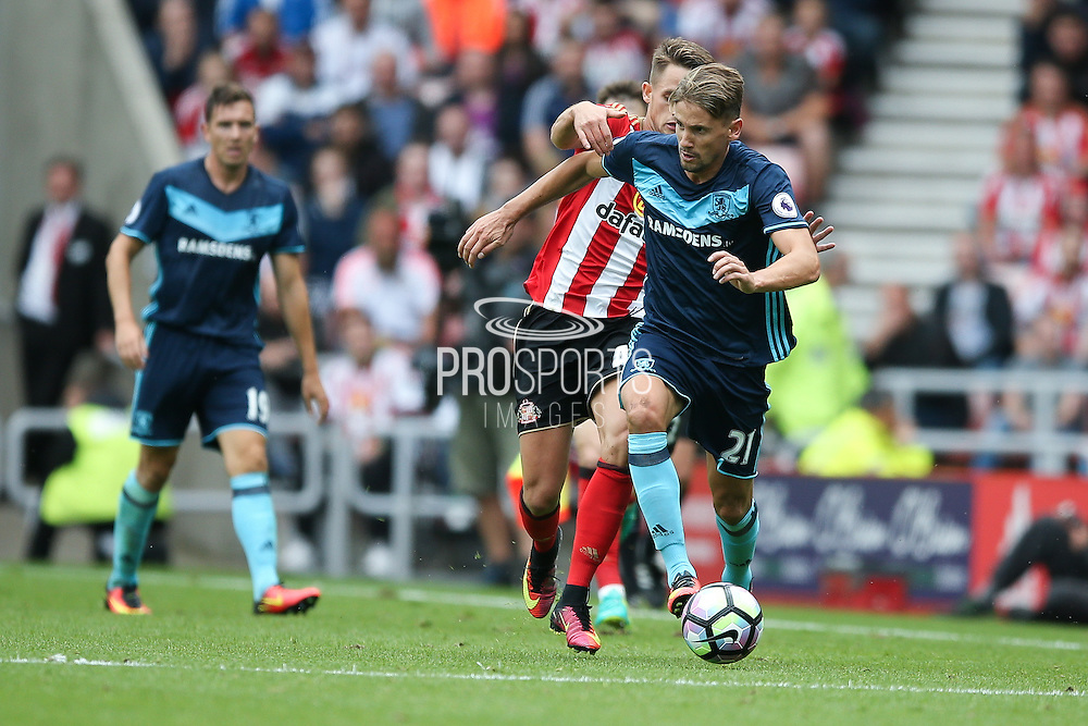Middlesbrough midfielder Gaston Ramirez (21)  gets away  during the Premier League match between Sunderland and Middlesbrough at the Stadium Of Light, Sunderland, England on 21 August 2016. Photo by Simon Davies.
