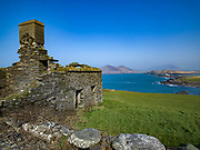An old farmers cottage overlooks Valentia Island Lighthouse on the Wild Atlantic Way in County Kerry Ireland.<br /> Picture by Don MacMonagle -macmonagle.com