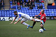 Tranmere Rovers' Ryan Lowe is sent flying  by Oldham Athletic's  Gary Harkins.  Skybet football league 1match, Tranmere Rovers v Oldham Athletic at Prenton Park in Birkenhead, England on Saturday 1st March 2014.<br /> pic by Chris Stading, Andrew Orchard sports photography.