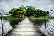 Bridge to Petencito Zoo over Lago Peten Itza. Flores, Guatemala