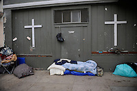 Possessions line up against the wall of the Victory Mission on Soledad Street. The city's sweep on January 31st seems to have cleaned up the area temporarily, but without viable places to go, many homeless have returned to the spots they once claimed.