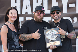 Buckcherry drummer Xavier Muriel gives out the Led Sled award at the Harley-Davidson Editors Choice Custom Bike Show during the annual Sturgis Black Hills Motorcycle Rally. SD, USA. August 9, 2016. Photography ©2016 Michael Lichter.