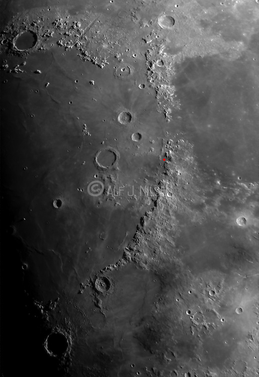 Moon surface and large craters around the Apennines, Mare Serenitatis and Mare Imbrium.  Apollo 15 landing site is marked in red.