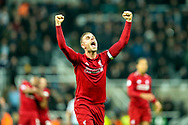 Jordan Henderson (#14) of Liverpool celebrates following Liverpool's victory in the Premier League match between Newcastle United and Liverpool at St. James's Park, Newcastle, England on 4 May 2019.
