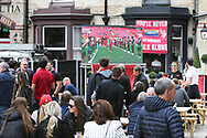 Big screens, beer and a guard of honour as fans celebrate outside the stadium and through the city before and during the Premier League match between Liverpool and Aston Villa at Anfield, Liverpool, England on 5 July 2020.