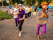 24 FEBRUARY 2015 - PHNOM PENH, CAMBODIA: Women do aerobic exercises set to Cambodian pop music on the riverfront in Phnom Penh.    PHOTO BY JACK KURTZ