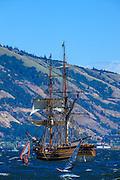 USA, Oregon, Hood River, windsurfers and Lady Washington of the Grays Harbor Historical Seaport Authority.