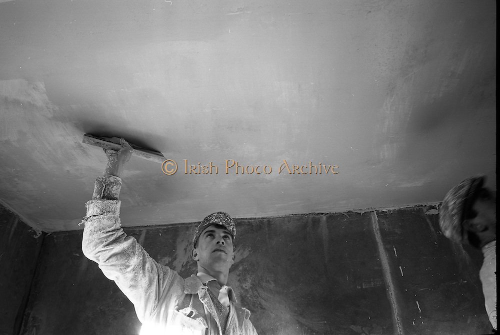 Plastering at the Ballymun Housing Scheme. The Ballymun tower blocks were seven landmark residential towers built to accommodate the rising population, and particularly to accommodate former residents of inner-city areas which were being cleared in the process of 1960s 'urban slum clearances'. <br /> 03.01.1968
