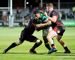 Benetton Treviso's Monty Ioane is tackled by Dragons' Lewis Evans<br /> <br /> Photographer Simon King/Replay Images<br /> <br /> Guinness PRO14 Round 1 - Dragons v Benetton Treviso - Saturday 1st September 2018 - Rodney Parade - Newport<br /> <br /> World Copyright © Replay Images . All rights reserved. info@replayimages.co.uk - http://replayimages.co.uk