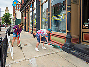 31 MAY 2020 - DES MOINES, IOWA: Workers clean up glass in front of Court Ave Brewing, a Des Moines brew pub, after the windows were shattered by rioters early Sunday morning. A group of rioters, protesting the death of George Floyd in police custody in Minneapolis, smashed windows in businesses and restaurants around the Polk County Courthouse in Des Moines. Des Moines police said they made 25 arrests Saturday night and very early Sunday morning. No one was hurt in the disturbances.      PHOTO BY JACK KURTZ