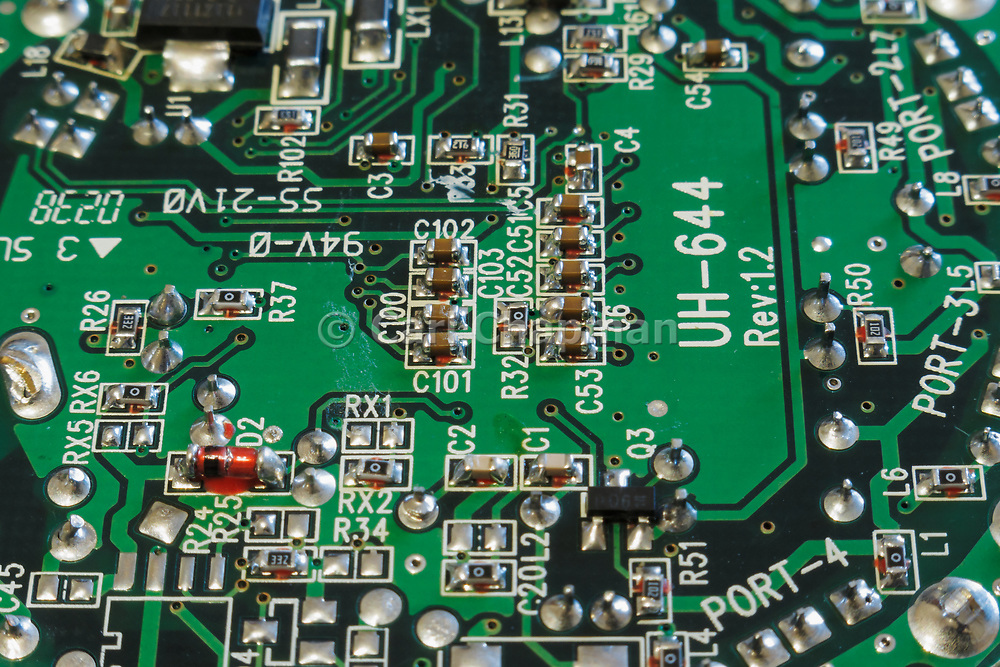 Surface mount resistor and capacitor components on a printed circuit board PCB in a USB router. <br /> <br /> Editions:- Open Edition Print / Stock Image
