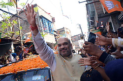 April 27, 2017 - Kolkata, West Bengal, India - Amit Shah greets his party member and local people during his visit to Rajarhat Newtown Constituency as a part of his 'Booth Chalo' program. Bharatiya Janta Party President, Amit Shah visits a semi urban area of Rajarhat Newtown Constituency in north sub urban of Kolkata during his 15-days long Vistaar Yatra or expansion tour program. (Credit Image: © Saikat Paul/Pacific Press via ZUMA Wire)