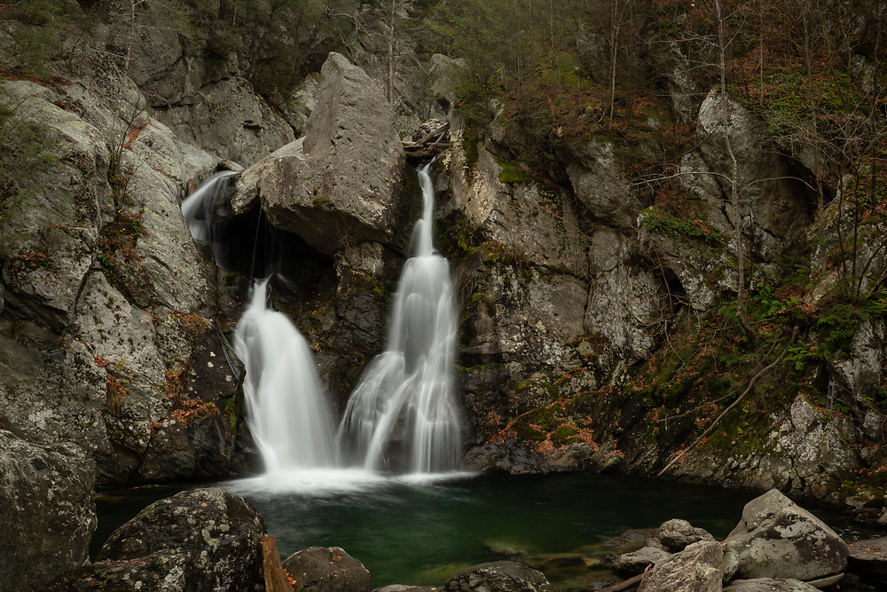 The splitting cascades at Bash Bish Falls seen on a cold autumn afternoon in The Berkshires.