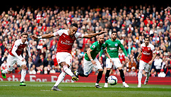 Arsenal's Pierre-Emerick Aubameyang scores his side's first goal of the game from the penalty spot during the Premier League match at the Emirates Stadium, London.