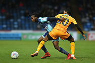 Wycombe Wanderers Dan Rowe(18) and Cambridge United's Jevani Brown(20) during the EFL Sky Bet League 2 match between Wycombe Wanderers and Cambridge United at Adams Park, High Wycombe, England on 10 March 2018. Picture by Alistair Wilson.